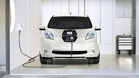 IMAGE-white car charging in white garage